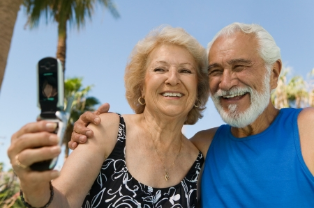 Senior Couple Taking Picture on Cell Phone Stock Photo - 18778471