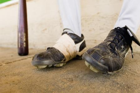 dugout: Close-up of Baseball Players Feet