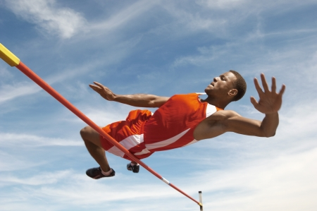 individual sport: High Jumper Clearing the Bar