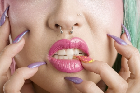 finger on lips: Close-up of a womans mouth and fingers