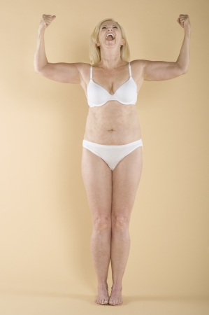 blonde underwear: Woman showing her biceps LANG_EVOIMAGES