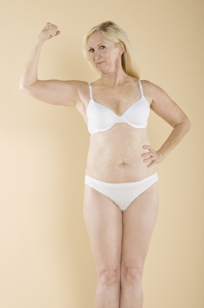 partially nude: Woman flexing her arm