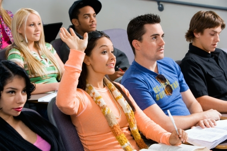 high school series: Student raising hand during class lecture LANG_EVOIMAGES