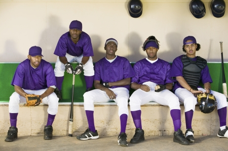 baseball dugout: Baseball Team Sitting in Dugout