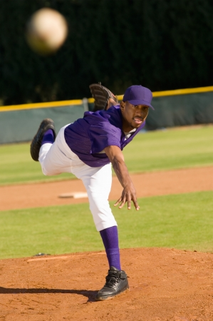 pitchers mound: Baseball pitcher throwing ball