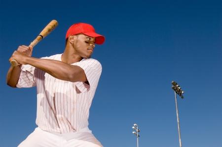 baseball cap: Baseball batter preparing to hit ball