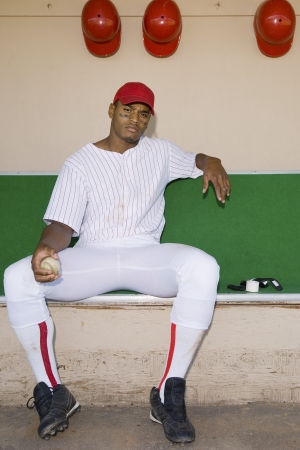 baseball dugout: Baseball Pitcher Sitting in Dugout