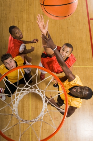 a basketball player: Basketball match view from above rim