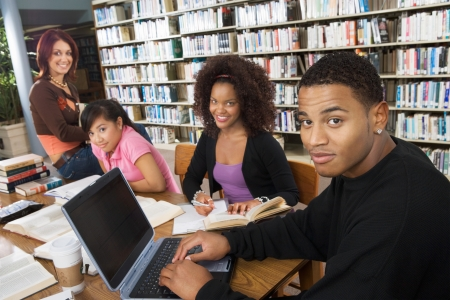 college student: College students studying together in library
