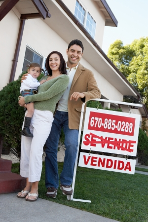 homeowners: Happy Homeowners with  Sign LANG_EVOIMAGES