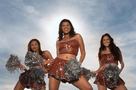 pom poms: Cheerleaders doing routine with pom poms
