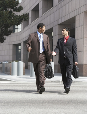racially diverse: Two Businessmen Walking LANG_EVOIMAGES