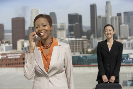 late thirties: Businesswoman on a Cell Phone