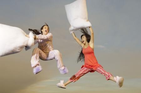Pillow fight: Women Having Pillow Fight