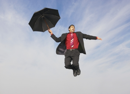 cautious: Falling Businessman with Umbrella
