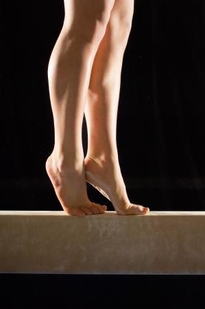 balance beam: Gymnast (13-15) on balance beam low section