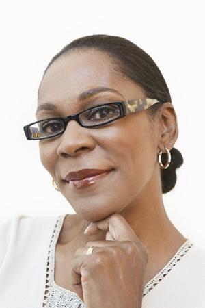 hair blacks: Middle aged woman wearing glasses portrait (portrait)