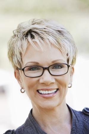 one mature woman only: Elegant mature woman wearing glasses portrait