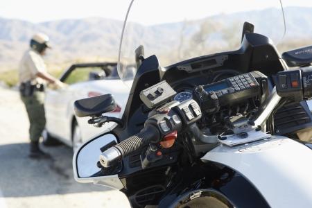 motor officer: Police Officer Stopping a Speeding Car