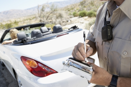 Woman Receiving Speeding Ticket