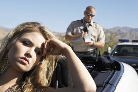exasperation: Woman Receiving Speeding Ticket