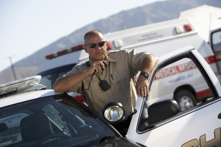 Police car: Police Officer on Two-Way Radio
