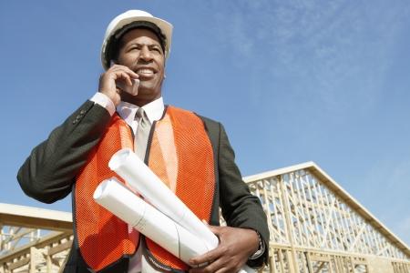 floorplan: Surveyor Using Cell Phone on Construction Site