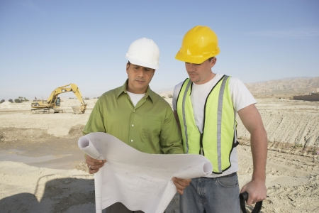 construction crew: Construction Workers Reading Blueprints