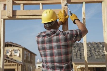 late forties: Construction Worker Working on Timber Frame LANG_EVOIMAGES