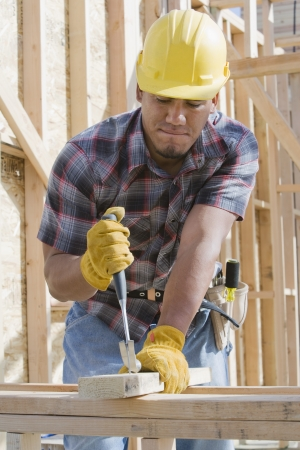 construction frame: Construction worker at work on building