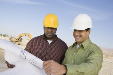 middle easterners: Two construction workers studying blueprint LANG_EVOIMAGES