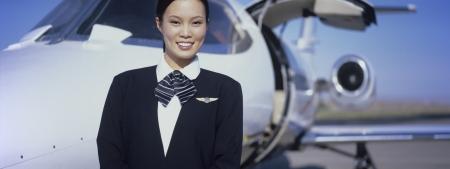 flight crew: Member of Flight Crew Standing by Airplane