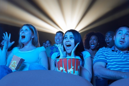 horror movie: Young People screaming watching Horror Movie in Theatre LANG_EVOIMAGES