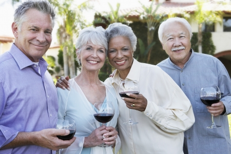 mature woman face: Friends Drinking Wine