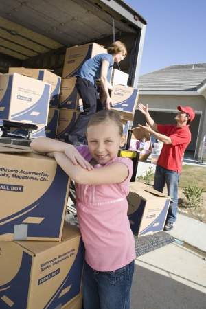 middle easterners: Portrait of girl (7-9) by truck of cardboard boxes LANG_EVOIMAGES