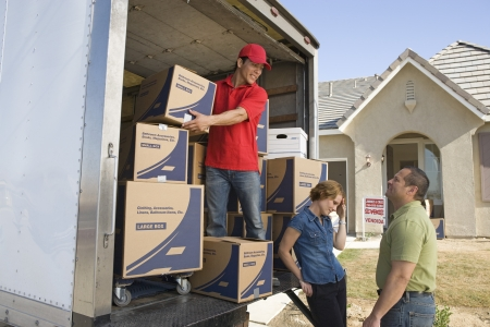 middle easterners: Man and couple unloading truck of cardboard boxes LANG_EVOIMAGES