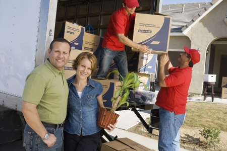 middle easterners: Portrait of couple and workers unloading truck