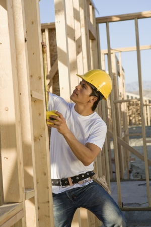 middle easterners: Construction worker on scaffoldings LANG_EVOIMAGES