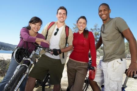 Friends Mountain Biking Together Banco de Imagens