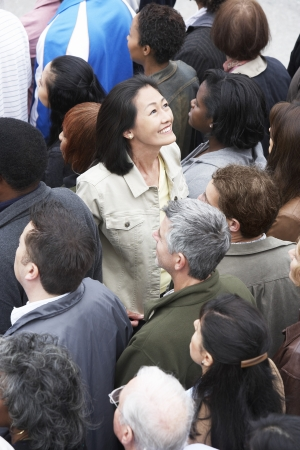 racially diverse: Woman at Rally Looking Up