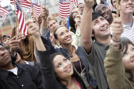 racially diverse: People Waving American Flags