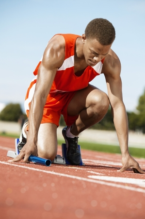 beforehand: Runner Waiting in Starting Block