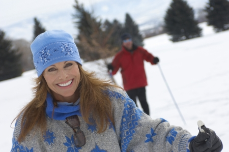 ski area: Smiling Woman Out Cross-country Skiing LANG_EVOIMAGES