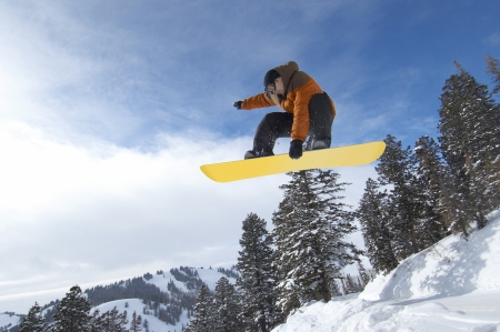 winter sports: Snowboarder in Mid-air LANG_EVOIMAGES