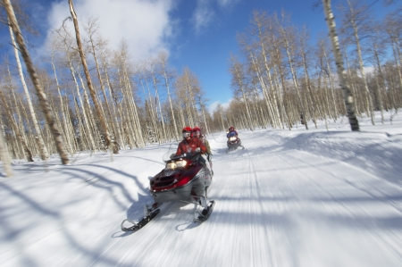 late thirties: Couples Racing on Snowmobiles