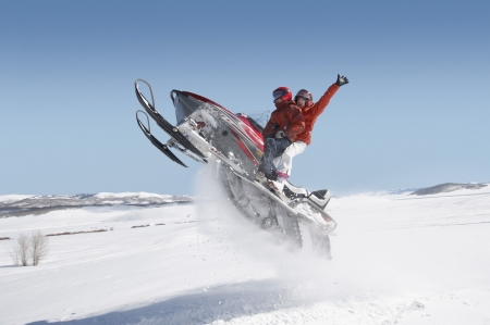 zeal: Couple Mid-air on Snowmobile LANG_EVOIMAGES