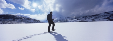exerting: Man Hiking Through Snow LANG_EVOIMAGES