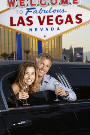 holidaymaker: Couple Toasting in Limousine LANG_EVOIMAGES
