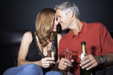 Couple Drinking Champagne in Limousine Stock Photo - 18800419
