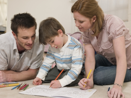 35 to 40 year olds: Parents on Floor Coloring With Son